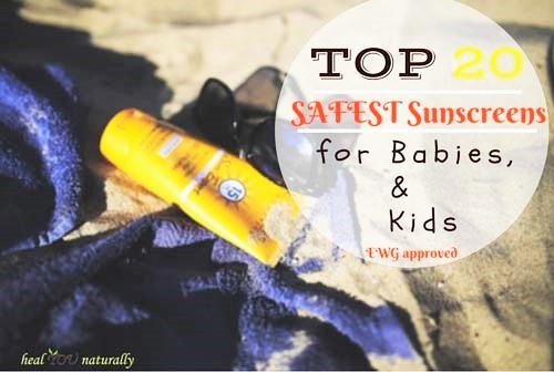 sunscreens for babies bottle and towel on the sand