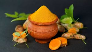 turmeric powder in a fancy container