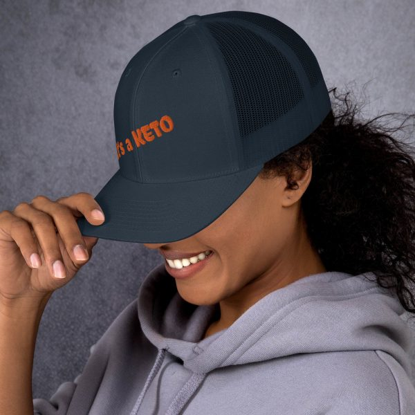 blue beig hat keto  orange letters side